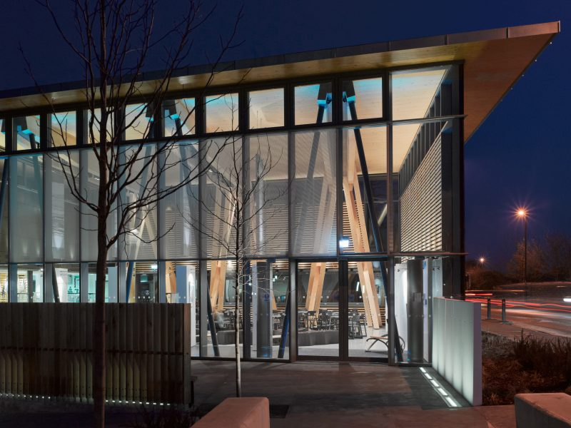 Night view entrance of HCA Arts Space with timber structure and led lighting.