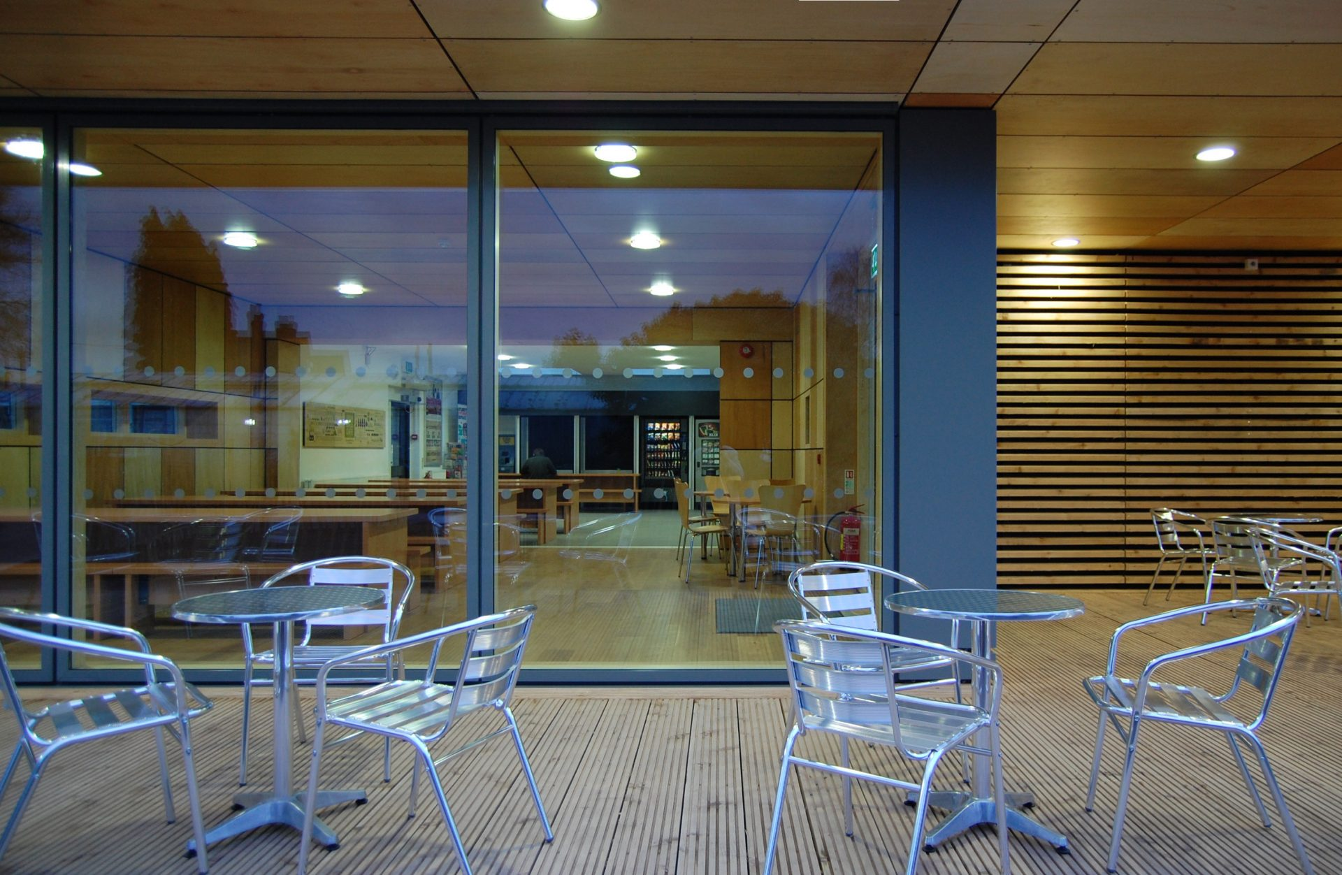 Straw Bale Cafe Exterior Plywood Cedar Velfac Decking Tables Chairs