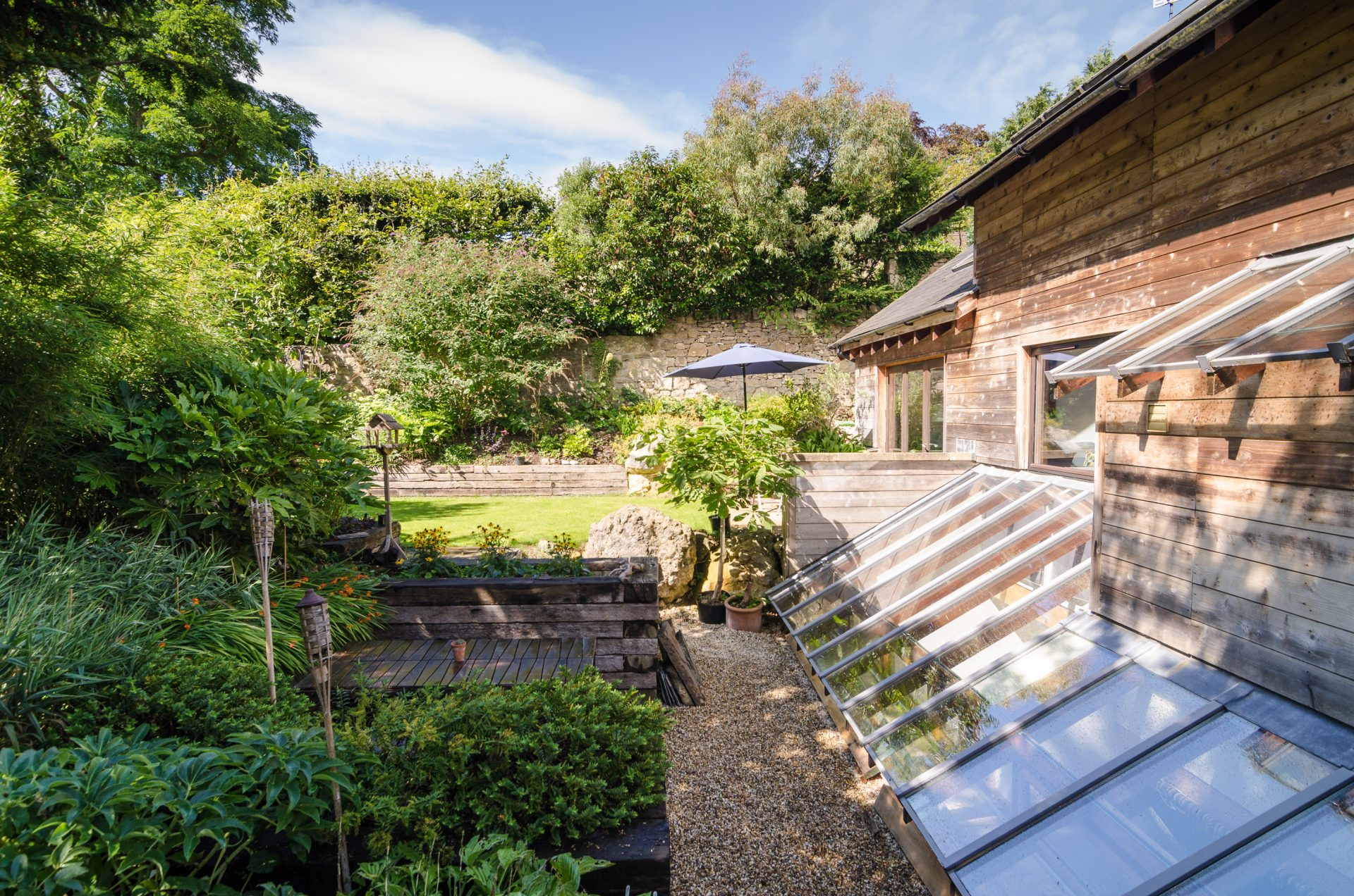 Sion Road Eco-Home Lean-to Glass Roof Timber Cladding